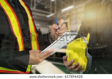 2 male occupational health and safety officer inside factory doing inspection