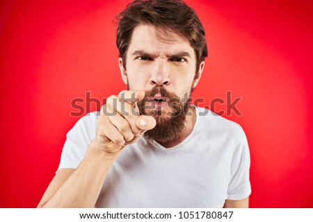 man angry finger pointing at the camera, emotions                               #1051780847