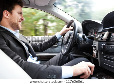 Man driving his car - stock photo