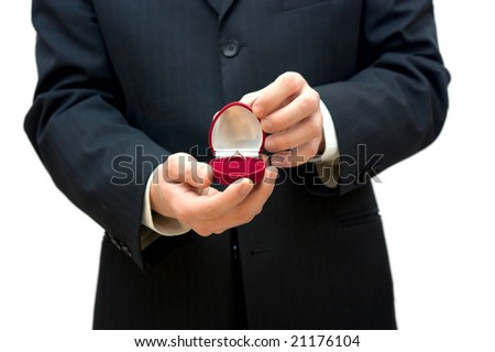 man holding box with wedding ring
