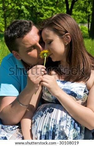 man hugs a pregnant wife