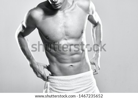 man in towel naked torso press muscular body