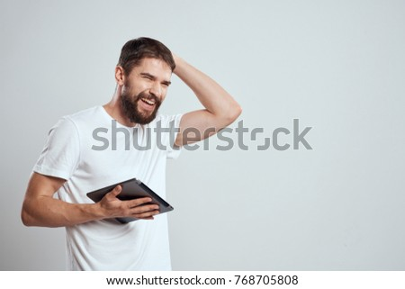 man laughs in his hand tablet, logo