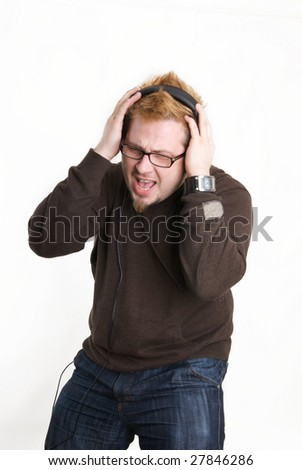 man listens to music on the headphones