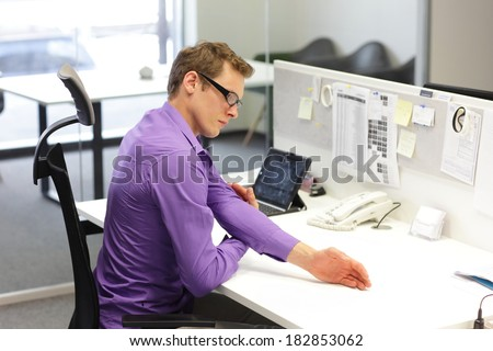 man  office worker,exercising during work with tablet in his office