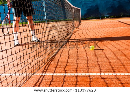 man playing tennis on clay court - stock photo