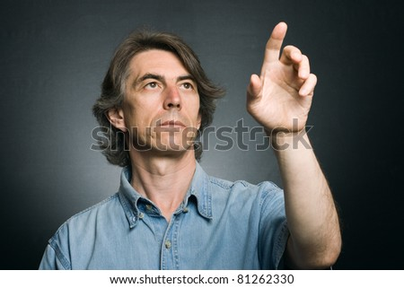 man pushing an imaginary button touch