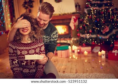 Man surprise woman for Chrismas