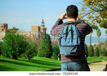 man tourist photographing in a botanical garden and  Park de la Ciutadella in Barcelona