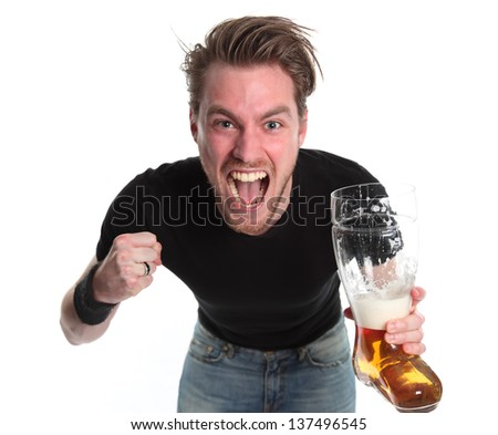 Man with a boot shaped beer glass wearing a black t-shirt. White background.