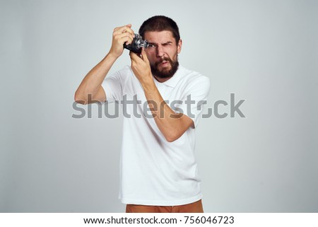 man with an old camera on a white background, emotional portrait                               #756046723