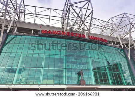 MANCHESTER, ENGLAND - JULY 6, 2014: Old Trafford stadium is home to Manchester United one of the wealthiest and most widely supported football teams in the world.