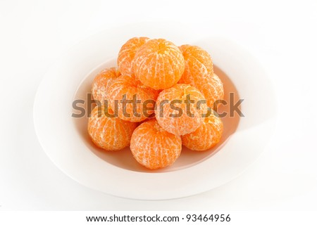 Mandarin orange on white dish - stock photo