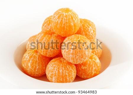 Mandarin orange on white dish