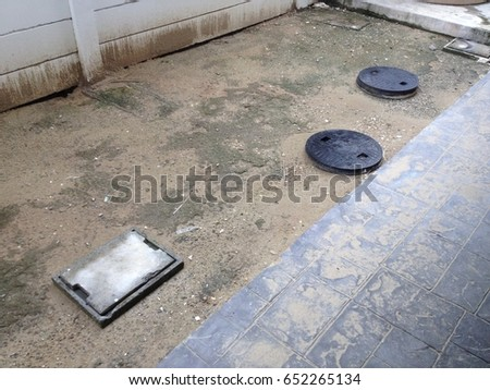 ?manhole grease trap and septic tank  behind the house