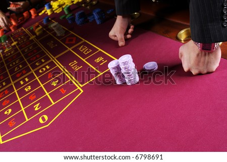 2 mans hands on a red casinos table . - stock photo