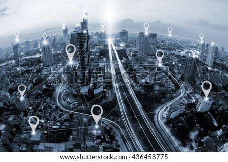 Map pin flat above blue tone city scape and network connection concept\n