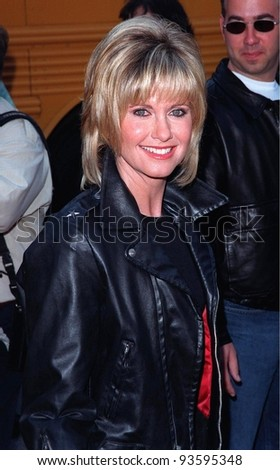 """15MAR98:  """"Grease"""" star OLIVIA NEWTON JOHN at 20th anniversary re-premiere of """"Grease"""" at Mann's Chinese Theatre, Hollywood. - stock photo"""