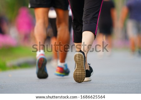 Marathon running Blured of people are walking in urban park. blurred in fitness and healthy active lifestyle feet on road                                    ストックフォト ©