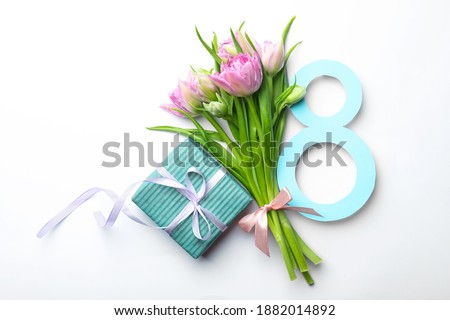8 March greeting card design with tulips and gift on white background, top view Photo stock ©
