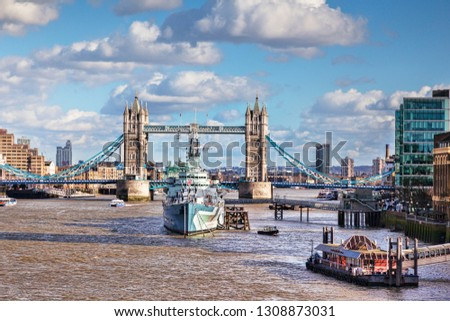 2 March 2015:  London, UK - HMS Belfast on the River Thames, and Tower Bridge.
