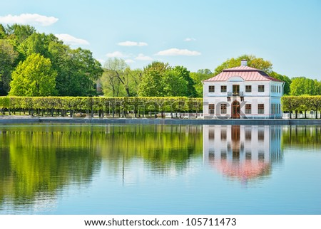 marly palace on the bank of pond in peterhof in russia
