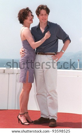 """15MAY98:  Actor HUGH GRANT & actress JEANNE TRIPPLEHORN at the Cannes Film Festival to promote their new movie """"Mickey Blue Eyes."""""""