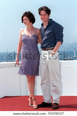 """15MAY98:  Actor HUGH GRANT & actress JEANNE TRIPPLEHORN at the Cannes Film Festival to promote their new movie """"Mickey Blue Eyes."""" - stock photo"""