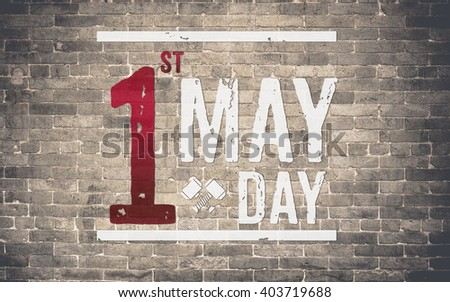 1 May day (International Labor day) on brick wall,holiday concept.