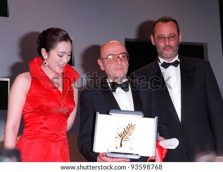 24MAY98:  Director THEO ANGELOPOULUS (center), winner of the Palme D'Or, with actress GONG LI & actor JEAN RENO at the Cannes Film Festival awards ceremony.