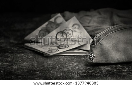 9 May, Victory Day holiday background. military cap, soldier's war letter. traditional symbol of Victory Day 1945. black and white tone. copy space