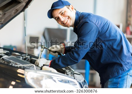 Mechanic at work in his garage