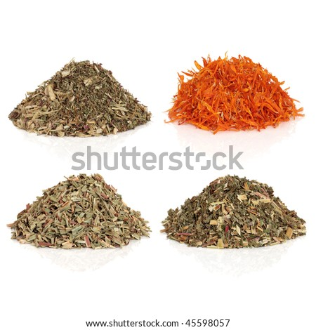 Medicinal and magical herb selection used in healing and to make potions and cast spells, echinacea, marigold flower petals, lemon grass and meadowsweet. Top left to bottom right.