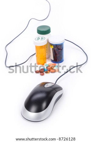 Medicine and computer mouse, concept of online pharmacy