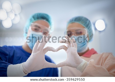 medicine, people, charity, health care and cardiology concept - doctors hands  making heart shape