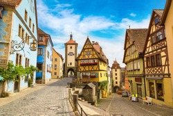 Medieval old street in Rothenburg ob der Tauber in a beautiful summer day, Germany