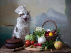 Mediterranean vegetarian still life with a cat in a chef's hat
