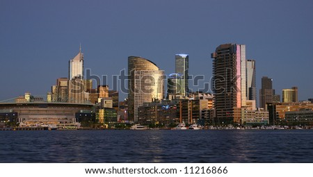 - Melbourne at dusk; view towards Docklands; company logos were removed; Melbourne, Victoria, Australia