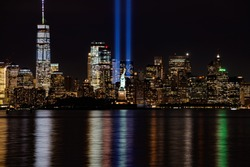 9/11 Memorial Lights with Statue of Liberty shot from New Jersey