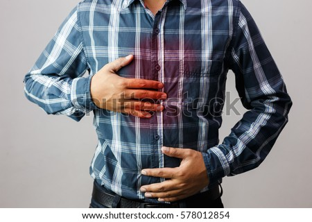 Men have symptoms of burning sensation in the middle of the chest caused by acid reflux. /Health and medical concepts.