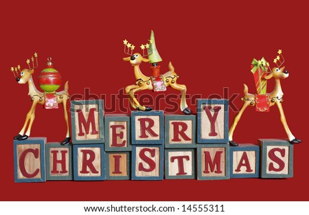 """""""merry christmas"""" spelled out in blocks with whimsical reindeer"""