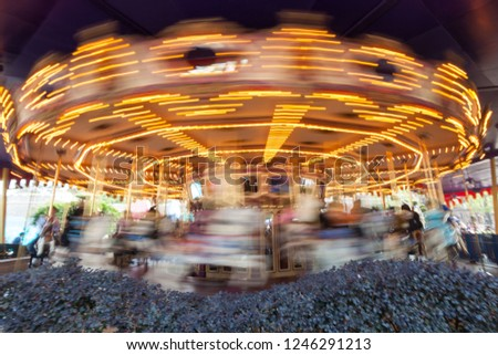 \nMerry Go Round view during spinning in long exposure in Hong Kong Disneyland