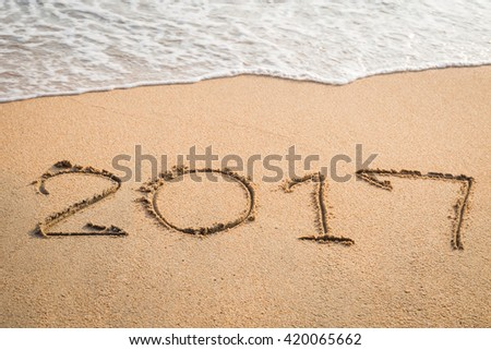2017,  message written in the sand at the beach background #420065662