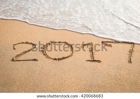 2017 message written in the sand at the beach background #420068683