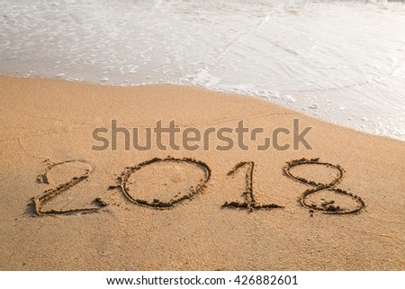 2018 message written in the sand at the beach background #426882601