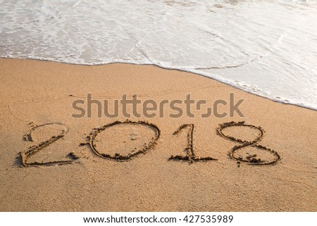 2018 message written in the sand at the beach background #427535989
