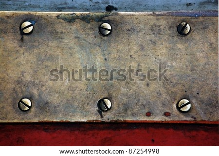 metal design of cooper plates and screws, grunge abstract background