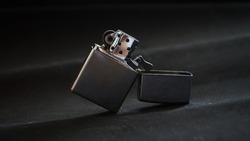 metal gasoline lighter on black background