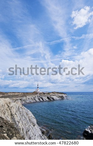 stock-photo--meters-tall-favaritx-lighthouse-seems-to-be-at-the-end-of-the-world-but-its-in-minorca-spain-47822680.jpg