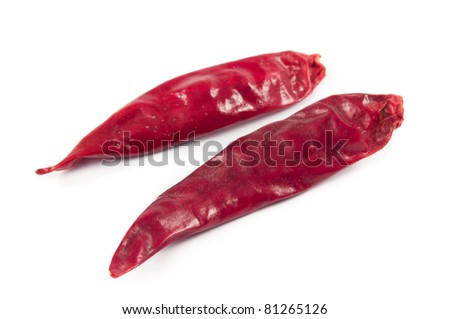 2 mexican peppers on white background called chile de arbol and very spicy